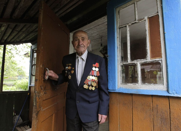 May 8, 2012: World War Two veteran Alexander Blotsky, 92, poses for a photo at his house on the eve of Victory Day in the town of Turov, some 270 km (167 miles) south of Minsk. Belarus will celebrate the 67th anniversary of the Soviet Union's victory over Nazi Germany in World War Two on May 9. (Vasily Fedosenko/Retures)