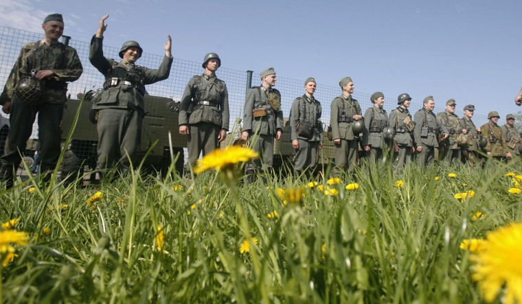 """May 6, 2012: Military enthusiasts take part in a re-enactment of a World War II battle at the """"Stalin Line"""" memorial, near the village of Goroshki, about 30 km (19 miles) west of Minsk. Belarus will celebrate the 67th anniversary of the Soviet Union's victory over Nazi Germany in World War Two on May 9. (Vladimir Nikolsky/Reuters)"""