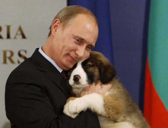 2010: Russia's Prime Minister Vladimir Putin hugs a Bulgarian shepherd dog, after receiving it as a present from Bulgaria's Prime Minister Boiko Borisov in Sofia, November 13, 2010. (Oleg Popov/Reuters)