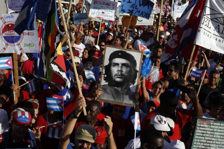 People carry a photograph of revolutionary hero Ernesto Che Guevara during the May Day parade at Havana's Revolution Square. (Enrique De La Osa/Reuters)
