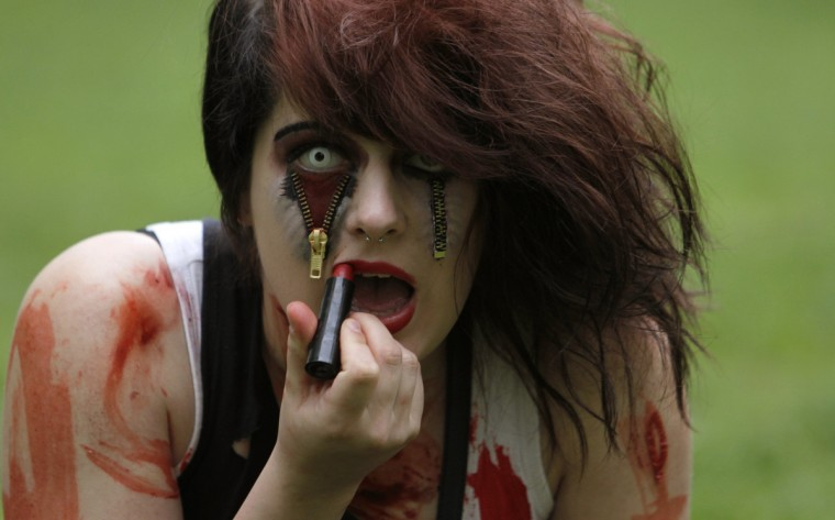 An enthusiast, dressed as a zombie, prepares for the Zombie Walk procession in Prague. (David W Cerny/Reuters)