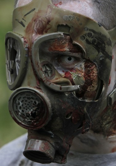 Gas mask zombie.... An enthusiast dressed as a zombie takes part in a Zombie Walk procession in Prague. (David W Cerny/Reuters)
