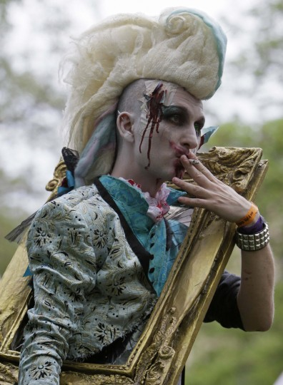 Framed zombie... An enthusiast dressed as a zombie takes part in a Zombie Walk procession in Prague. (David W Cerny/Reuters)