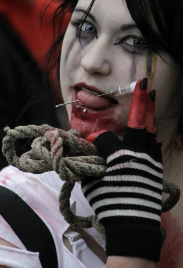 Pierced zombie... An enthusiast dressed as a zombie takes part in a Zombie Walk procession in Prague. (David W Cerny/Reuters)