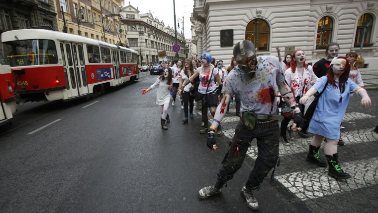 Every day we're shuffling.... Enthusiasts, dressed as zombies, march through central Prague during the Zombie Walk procession. (David W Cerny/Reuters)