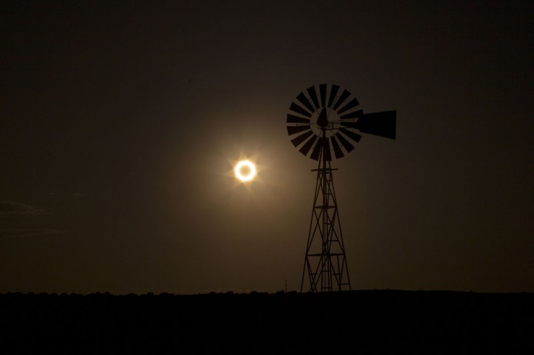 The moon passes between the sun and the earth behind a windmill near Albuquerque, New Mexico. (Lucas Jackson/Reuters)