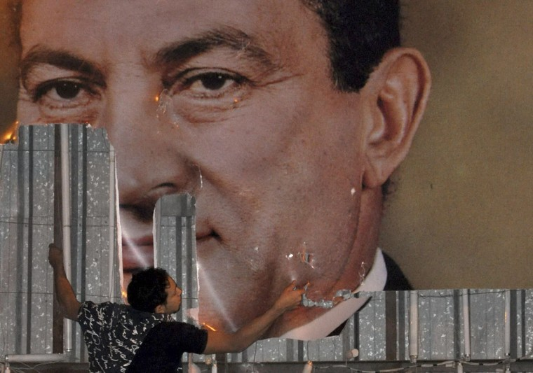 "January 25, 2011: An anti-government protester defaces a picture of Egypt's President Hosni Mubarak in Alexandria, 230 km (140 miles) north of Cairo. Thousands of Egyptians demanded an end to President Hosni Mubarak's 30-year rule and clashed with police in what was dubbed a ""Day of Rage."" (Stringer/Reuters)"