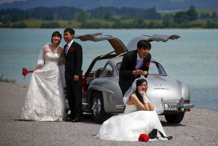 The couples pose after their symbolic wedding in Fuessen, Germany. (Michael Dalder/Reuters photo)