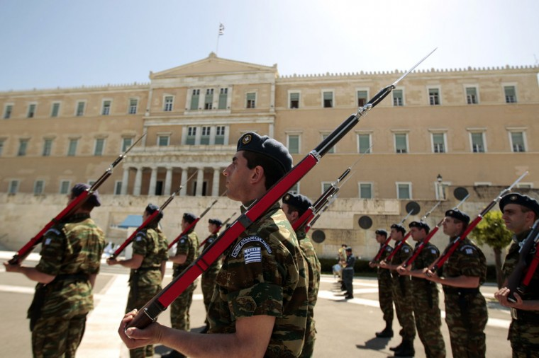 May 9, 2012: A guard of honour waits to be inspected by officials during an anniversary ceremony marking the end of World War II in front of the parliament in Athens. (Yorgos Karahalis/Reuters)