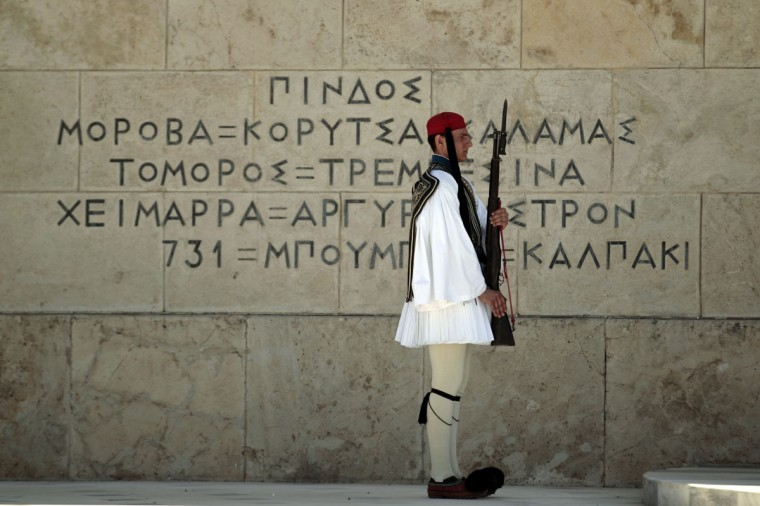 May 9, 2012: A Presidential guard pays tribute at the Tomb of the Unkown Soldier during an anniversary ceremony marking the end of World War II in front of the parliament in Athens. (Yorgos Karahalis/Reuters)