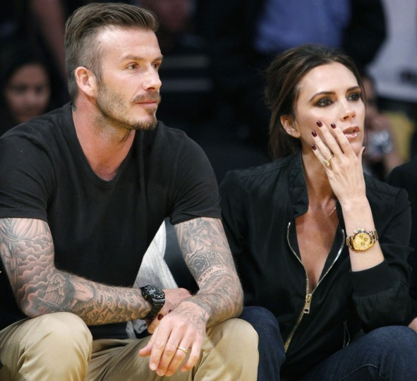 "The former ""posh"" Spice Girl Victoria Beckham and current soccer stud David Beckham have four sons: Harper, Brooklyn, Cruz and Romeo. Pictured: David sits courtside with his wife Victoria during Game 2 of the Los Angeles Lakers against Denver Nuggets NBA Western Conference quarter-final basketball playoff game in Los Angeles, California May 1, 2012. (/Alex Gallardo/Reuters)"