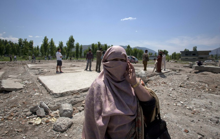 Naseem Bibi, a sacked Pakistani health worker, talks to the media on the site of the demolished compound of slain al-Qaida leader Osama bin Laden in Abbottabad May 2, 2012. (Mian Khursheed/Reuters)
