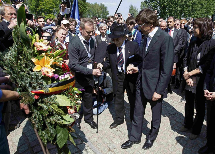 May 8, 2012: Belgian Prime Minister Elio Di Rupo (R) and Paul, baron Halter, a Belgian survivor of former Nazi death camp of Auschwitz Birkenau, lay flowers during a ceremony in Auschwitz Birkenau. (Yves Herman/Reuters)