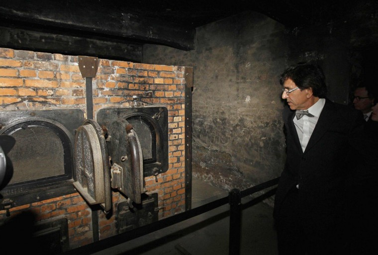 May 8, 2012: Belgian Prime Minister Elio Di Rupo looks at a crematorium at the former Nazi death camp of Auschwitz Birkenau. Among several ceremonies in many places in Europe, one thousand youths from all over Europe, aged between 16 to 18, participated in an international commemoration in Auschwitz Birkenau to celebrate the end of the second World War. (Yves Herman/Reuters)