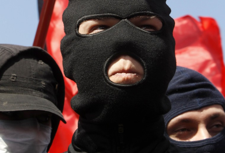 Russian anarchists march during a rally in Moscow. (Sergei Karpukhin/Reuters)