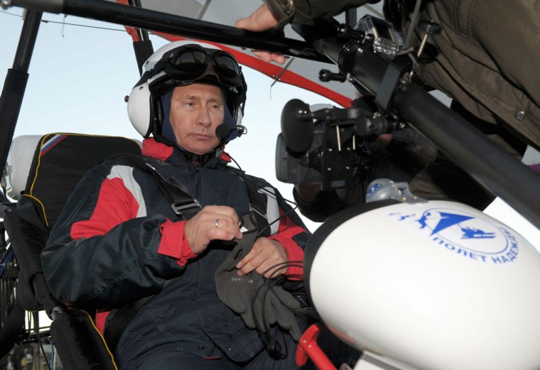 2012: Russian President Vladimir Putin sits in a motorised deltaplane at Yamalo-Nenets district September 5, 2012. Putin, who has tracked a Siberian tiger and posed with a polar bear, on Wednesday took his love of wildlife to new heights by flying with cranes - to lead them on a migration route. Picture taken September 5, 2012 (Alexsey Druginyn/RIA Novosti/Kremlin via Reuters)