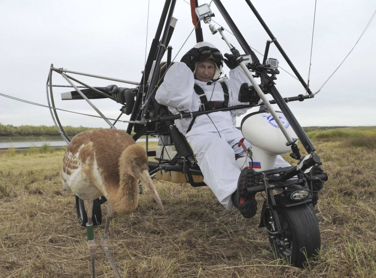 2012: Russian President Vladimir Putin sits in a motorised deltaplane near a crane at Yamalo-Nenets district September 5, 2012. (Alexsey Druginyn/RIA Novosti/Kremlin via Reuters)