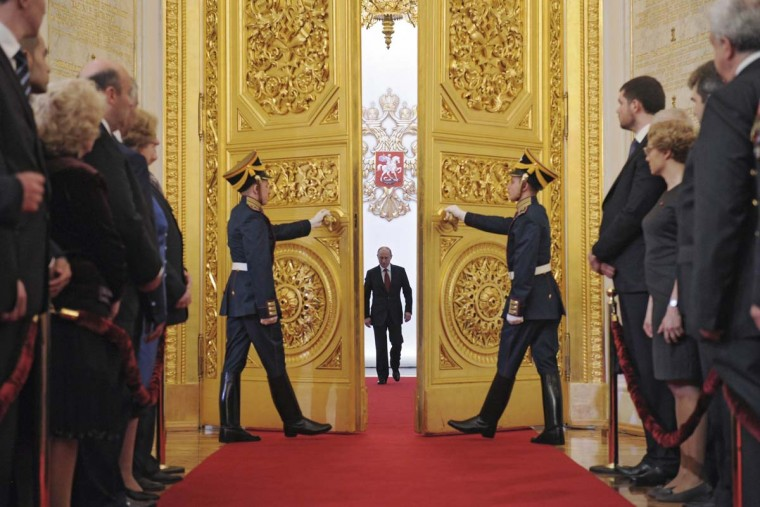 2012: Vladimir Putin (C) walks in as he attends the inauguration ceremony at the Kremlin in Moscow, May 7, 2012. Vladimir Putin appealed for unity in Russia after being sworn as president on Monday and pledged to strengthen democracy in his new six-year term. (Alexsey Druginyn/RIA Novosti/Pool/Reuters)