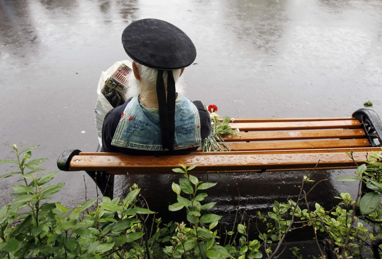 May 9, 2012: World War II veteran Fyodor Bortsov, 86, sits in Gorky Park during a Victory Day celebration in Moscow. (Denis Sinyakov/Reuters)