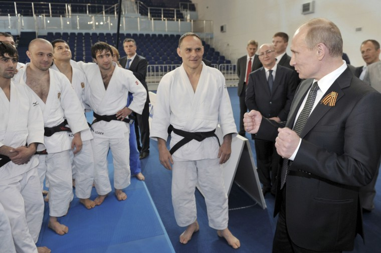 Russia's President Vladimir Putin (R) talks to athletes as he visits the Academy of Judo in Zvenigorod in Moscow Region, May 8, 2012. (Aleksey Nikolskyi/RIA Novosti/Reuters)