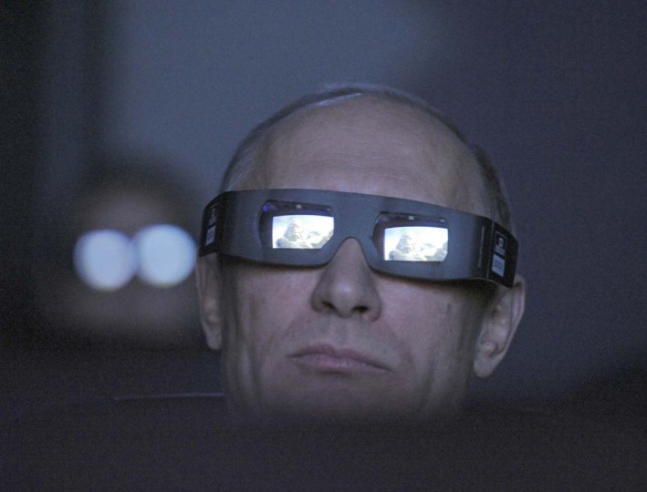 2012: Vladimir Putin, wearing a pair of glasses, watches the main program of the Planetarium on the Day of Aviation and Cosmonautics and the 51st anniversary of Yuri Gagarin's historic first space flight in Moscow April 12, 2012. (Alexsey Druginyn/RIA Novosti/Reuters)