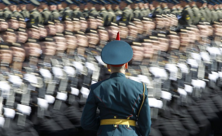 May 6, 2012: A Russian soldier stands at attention as troops march past during a general rehearsal for the upcoming Victory Day parade at Moscow's Red Square. (Denis Sinyakov/Reuters)