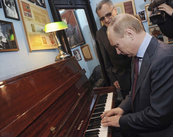 2012: Vladimir Putin plays the piano during his visit to a theatre in St. Petersburg April 10, 2012. (Yana Lapikova/RIA Novosti/Reuters)