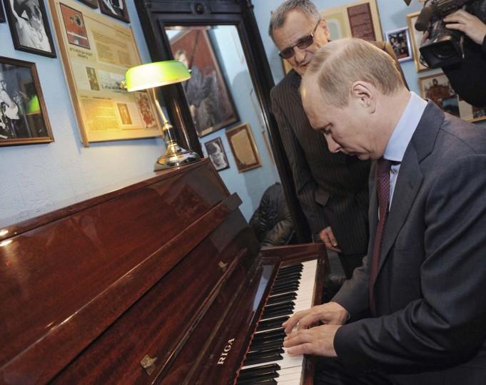 2012: Vladimir Putin plays the piano during his visit to a theatre in St. Petersburg April 10, 2012. (Yana Lapikova/RIA Novosti/Reuters)