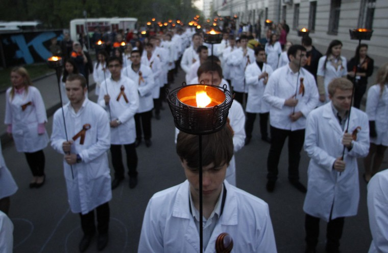May 3, 2012: Students of the Moscow State University of Medicine and Dentistry carry torches, symbolizing the university students who died during the World War Two, as they take part in a procession to mark the upcoming Victory Day in Moscow. Russia will celebrate the 67th anniversary of victory over Nazi Germany on May 9. (Maxim Shemetov/Reuters)