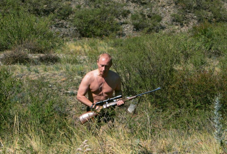 2007: Russia's President Vladimir Putin walks with a rifle in southern Siberia's Tuva region in this August 15, 2007 file photo. (Reuters)
