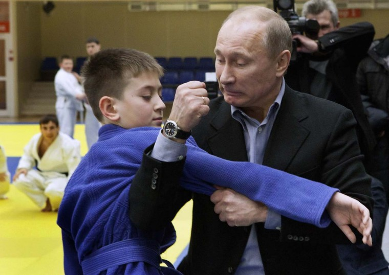 2012: Russian Prime Minister Vladimir Putin instructs a trainee during a judo demonstration at a regional judo centre in the city of Kemerovo, January 24, 2012. (Reuters)