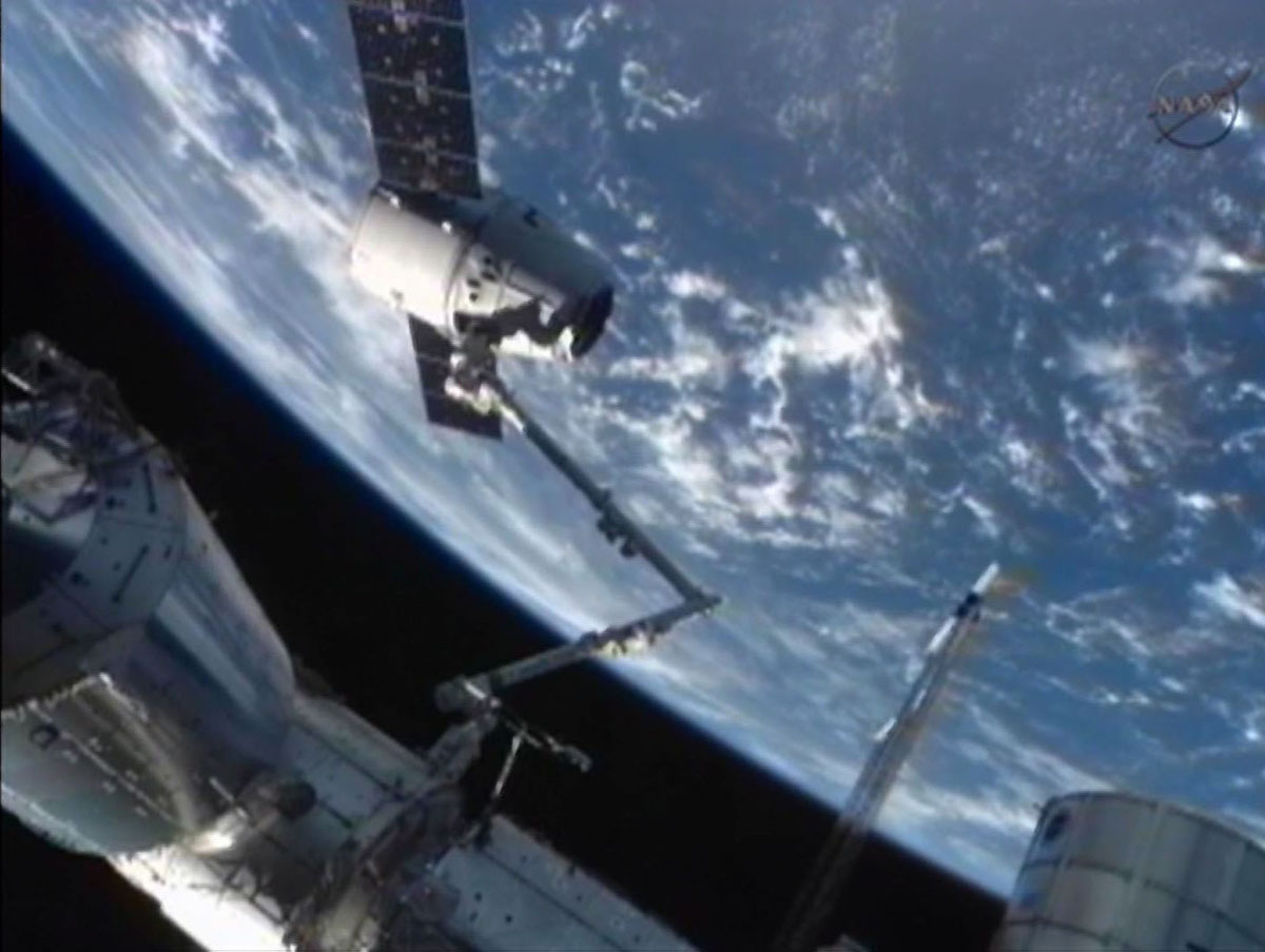The SpaceX Dragon commercial cargo craft is moved into ...