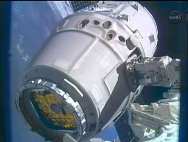 The SpaceX Dragon commercial cargo craft is moved into position for docking with the International Space Station using the station's Canadarm2 in this closeup image captured from NASA TV. (NASA TV/Reuters)