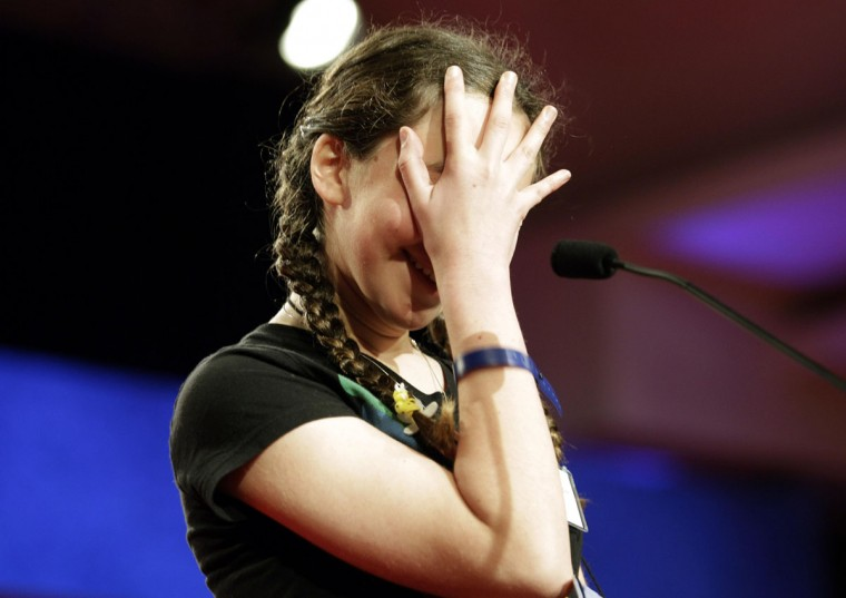 June 4, 2010: Sonia Schlesinger, 13, of Tokyo, Japan, reacts before spelling her name during the semi-finals of the 2010 National Spelling Bee in Washington. (Molly Riley/Reuters)