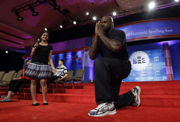 June 4, 2010: NBA basketball player Shaquille O'Neal makes an appearance onstage with 2009 National Spelling Bee champion Kavya Shivashankar (L) after the semi-finals of the 2010 National Spelling Bee in Washington. (Molly Riley/Reuters)