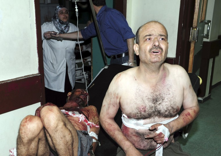 People wounded in an explosion are treated at a hospital in Damascus. Two explosions shook the Syrian capital Damascus on Thursday killing and wounding dozens of people. (Syrian Arab News Agency/Reuters)
