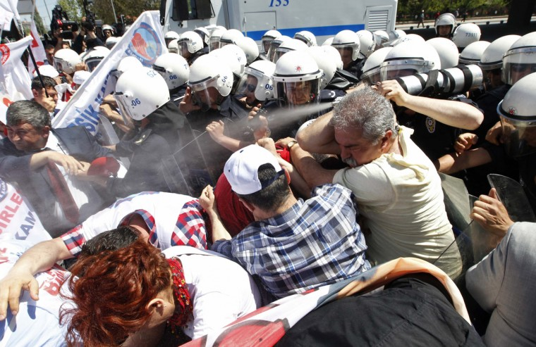 Riot police use tear gas against demonstrators during a May Day rally in central Ankara, Turkey. (Umit Bektas/Reuters)