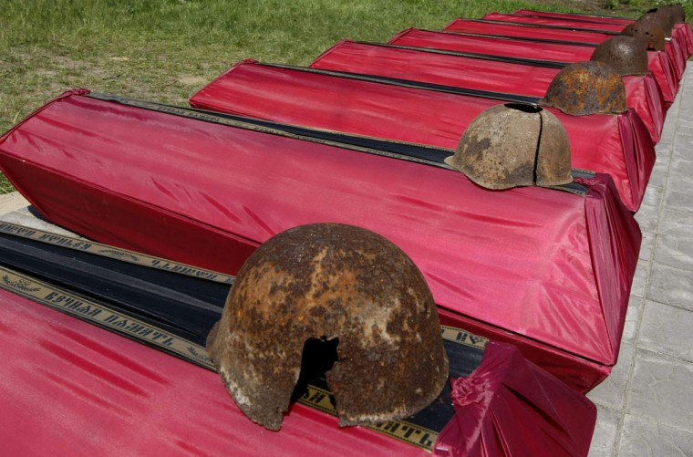May 6, 2012: Helmets rest on the coffins of the remains of soldiers killed in World War II during a reburial ceremony near the village of Petrivsk, some 70 km (43 miles) from Kiev. Ukraine marks the 67th anniversary of Soviet victory over Nazi Germany on May 9. (Anatolii Stepanov/Reuters)