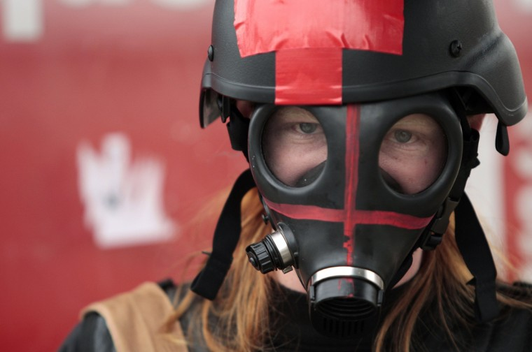 A medic wearing a gas mask is seen during May Day demonstrations in Los Angeles, California. (Jason Redmond/Reuters)