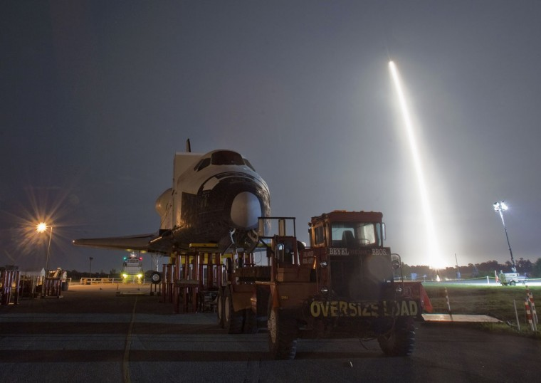 May 22, 2012: The SpaceX Falcon 9 test rocket lifts off from Space Launch Complex 40 at the Cape Canaveral Air Force Station in Cape Canaveral, Florida. The mock shuttle Explorer, in the foreground, had been on display at the Kennedy Space Center Complex, and will be moved to the Johnson Space Center in Houston this week in order to make room for the arrival of Space Shuttle Atlantis. (Pierre DuCharme/Reuters)