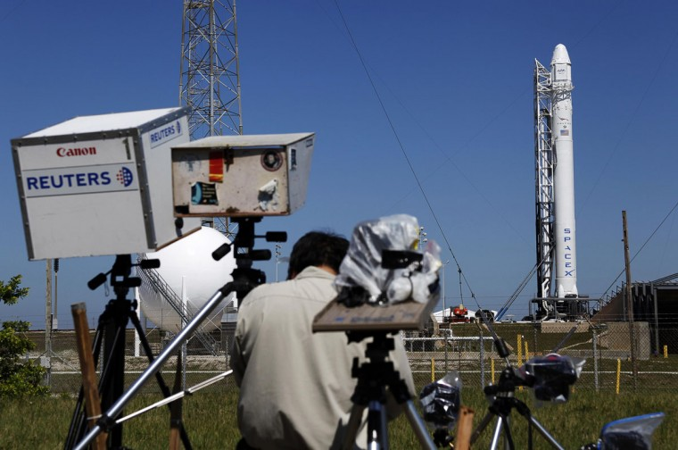 May 21, 2012: News photographers work on their remote cameras as the SpaceX Falcon 9 test rocket is being prepared for a second launch attempt from Space Launch Complex 40 at the Cape Canaveral Air Force Station in Cape Canaveral. The launch of SpaceX Falcon 9, scheduled for Tuesday, will mark for the first time a private company will send its own rocket to the orbiting International Space Station. (Michael Brown/Reuters)
