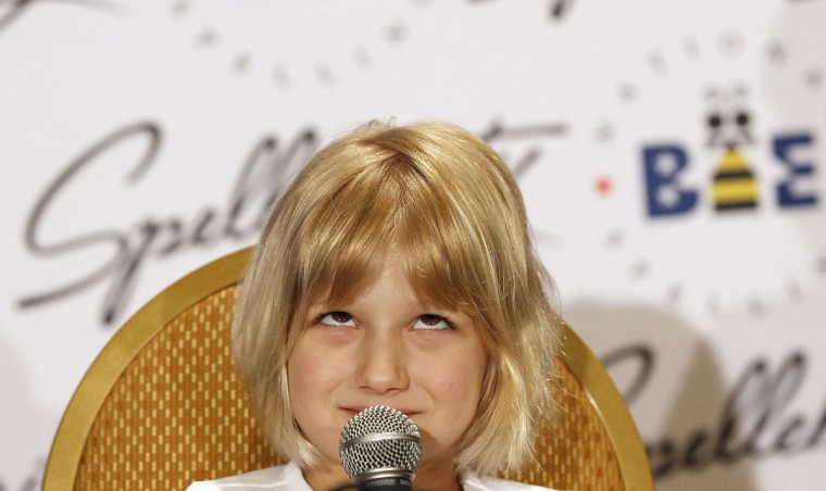 May 31, 2012: Six-year-old Lori Anne Madison ponders upon a question during a news conference at the Scripps National Spelling Bee semi-finals at National Harbor, Maryland. Madison, who was eliminated in Wednesday's round, is the youngest speller in the Spelling Bee's history. (Gary Cameron/Reuters)