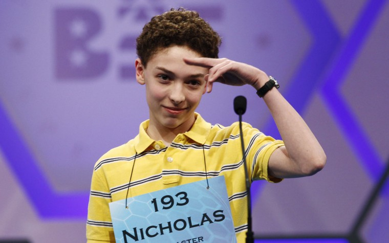 May 31, 2012: Nicholas Rushlow, 14, of Pickerington, Ohio, salutes goodbye after incorrectly spelling a word in the final round of the Scripps National Spelling Bee at National Harbor in Maryland. (Kevin Lamarque/Reuters)