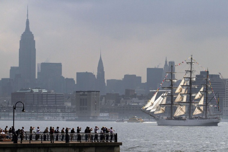The Brazilian Navy tall ship Cisne Branco makes its way up the Hudson River past lower Manhattan while arriving for the 25th annual Fleet Week celebration in New York May 23, 2012. (Eduardo Munoz/Reuters)