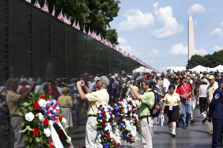 People visit the Vietnam Veterans Memorial wall, etched with the names of more than 58,000 U.S. servicemen and women who died in the war, on Memorial Day in Washington May 28, 2012. (Yuri Gripas/Reuters)