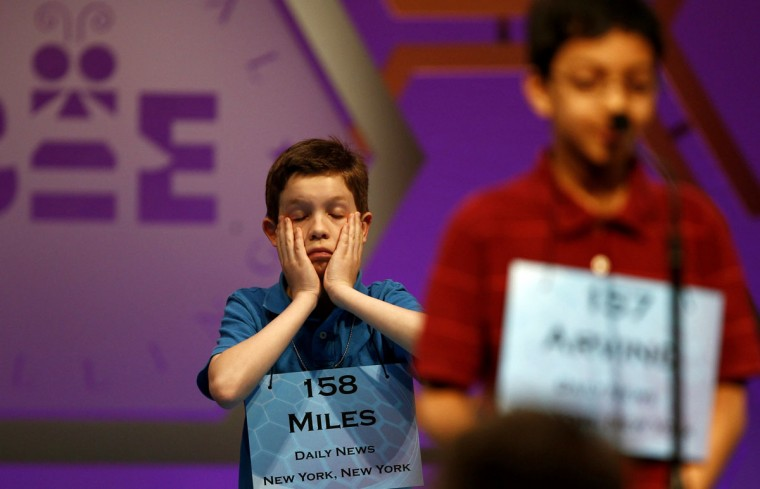June 1, 2011: Miles Shebar (L) of New York, waits his turn during round three of the 2011 Scripps National Spelling Bee at the Gaylord National Resort and Convention Center at National Harbor, Maryland. (Molly Riley/Reuters)
