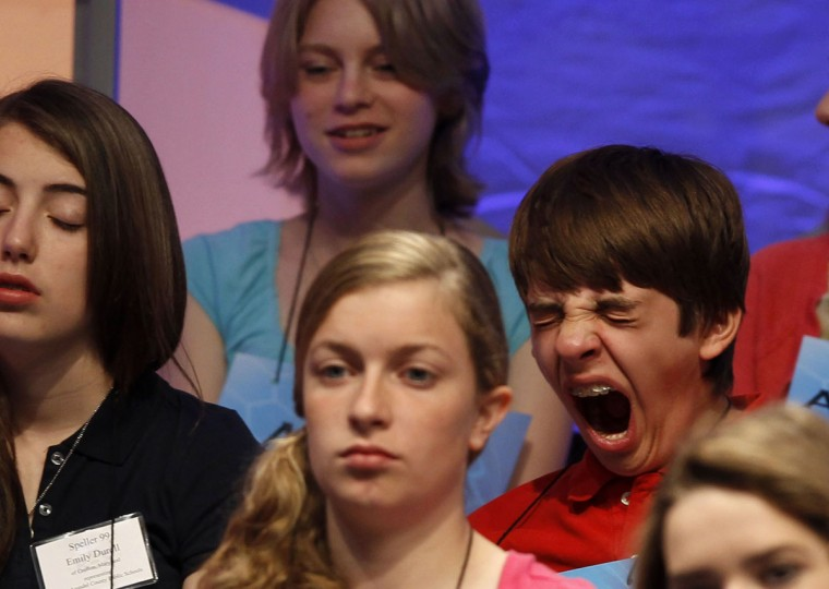 June 1, 2011: Robbie Palmisano of Baltimore (R) yawns while waiting his turn to spell a word in the preliminary round of the 2011 Scripps National Spelling Bee contest at the Gaylord National Resort and Convention Center in National Harbor, Maryland. (Larry Downing/Reuters)