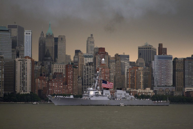 The USS Donald Cook makes its way up the Hudson River, past lower Manhattan, while arriving for the 25th annual Fleet Week celebration in New York May 23, 2012. (Eduardo Munoz/Reuters)