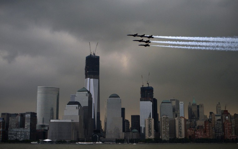 Members of the U.S. Navy Blue Angels fly over the World Trade Center in lower Manhattan as part of the 25th annual Fleet Week celebration in New York May 23, 2012. (Eduardo Munoz/Reuters)