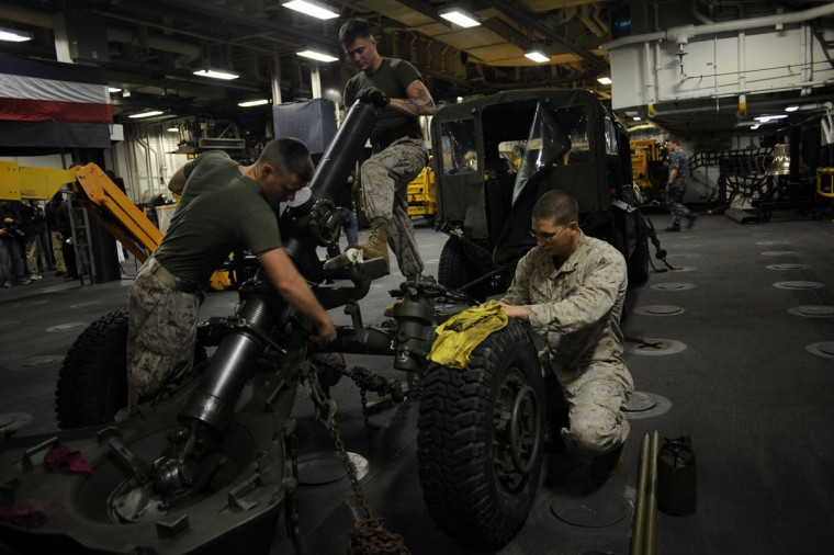 U.S. Marines clean a mortar on the USS Wasp as the amphibious assault ship enters into New York Harbor for Fleet Week May 23, 2012. (Keith Bedford/Reuters)
